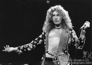 Robert Plant of Led Zeppelin posing on stage at MSG, NYC. February 1975. © Bob Gruen / www.bobgruen.comPlease contact Bob Gruen's studio to purchase a print or license this photo. email: websitemail01@aol.com phone: 212-691-0391